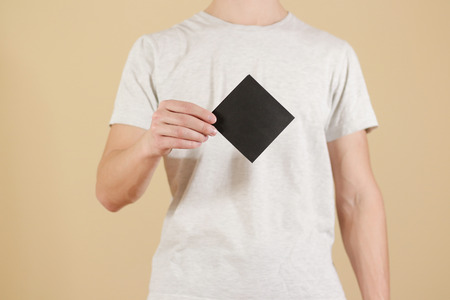 Man showing blank black square flyer brochure booklet. Leaflet presentation. Pamphlet hold hands. Man show clear offset paper. Sheet template. Booklet design sheet display read first person Stock Photo