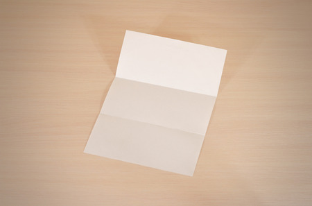 leaflet blank tri fold white paper brochure mockup on a wooden
