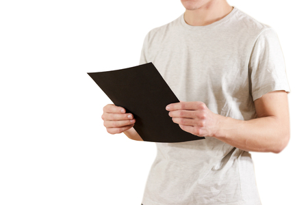 offset views: Man holding black A4 paper. Read booklet. Leaflet presentation. Pamphlet hold hands. Man show clear offset paper. Sheet template. Booklet design sheet display read first person Stock Photo