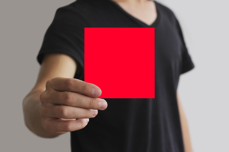 offset views: Man showing blank red square flyer brochure booklet. Leaflet presentation. Pamphlet hold hands. Man show clear offset paper. Sheet template. Booklet design sheet display read first person