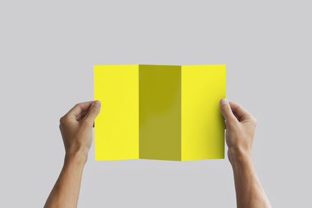 note booklet: Hand holding blank brochure booklet in the hand. Leaflet presentation. Pamphlet hand man. Man show offset paper. Sheet template. Book in hands. Booklet folding design. Fold paper sheet display read.