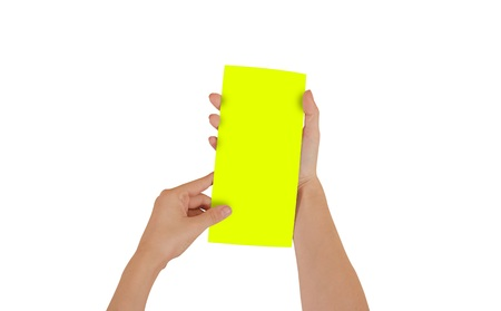 Hands holding blank yellow brochure booklet in the hand. Leaflet presentation. Pamphlet hand man. Show offset paper. Sheet template. Book in hands. Booklet folding design. Isolated on white background