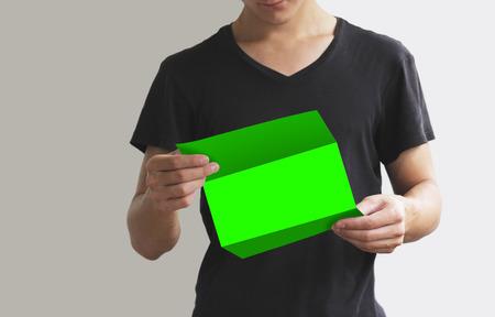 offset up: Man reading blank green flyer brochure booklet. Leaflet presentation. Pamphlet hold hands. Man show clear offset paper. Sheet template.