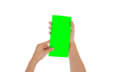 Hands holding blank green brochure booklet in the hand. Leaflet presentation. Pamphlet hand man. Show offset paper. Sheet template. Book in hands. Booklet folding design. Isolated on white background