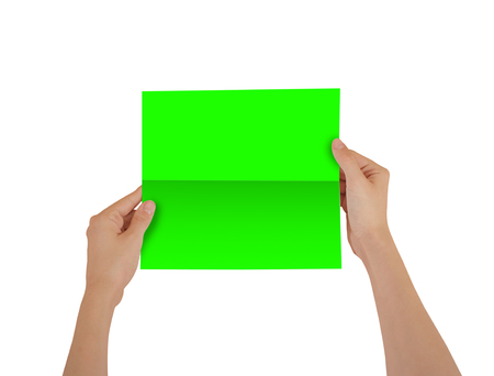 Hands holding blank green brochure booklet in the hand. Leaflet presentation. Pamphlet hand man. Show offset paper. Sheet template. Book in hands. Booklet folding design. Fold paper sheet display read
