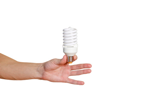 Closeup of mans hand holding energy saving lamp. Recycling, electricity, environment and ecology concept. The lamp is white. Isolated on white background