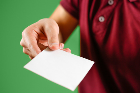 note booklet: Man showing blank white square flyer brochure booklet. Leaflet presentation. Pamphlet hold hands. Man show clear offset paper. Sheet template. Booklet design sheet display read first person. Stock Photo