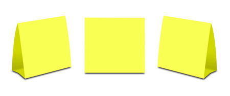 placecard: Blank Yellow Table Tent on white. Paper vertical cards isolated on white background. Front, left and right view. Stock Photo