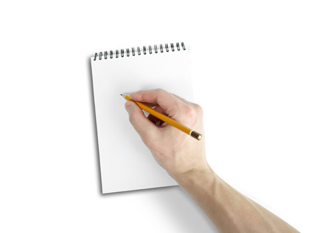 empty handed: Right hand writing on notebook with white background. Top view of work desk. Isolated on white background.
