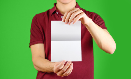 note booklet: Man showing blank white flyer brochure booklet. Leaflet presentation. Pamphlet hold hands. Man show clear offset paper. Sheet template. Booklet design sheet display read first person. On chromakey