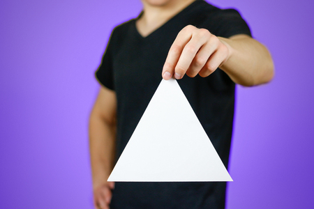 Man showing blank white triangular flyer brochure booklet. Leaflet presentation. Pamphlet hold hands. Man show clear offset paper. Sheet template. Booklet design sheet display read first person.