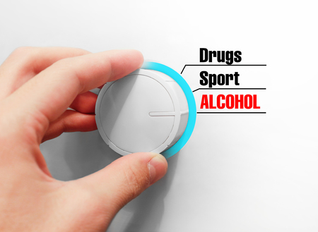 Male hand turns the switch. Switches lifestyle. Chose the Alcohol.