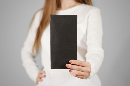 girl showing blank black flyer brochure booklet leaflet