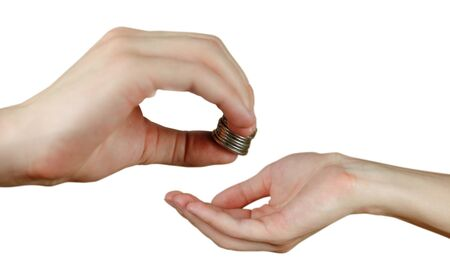 transfers: Hand puts coins in the other hand. Hands holding money. Transfers of coins. Isolated on a white background. Stock Photo