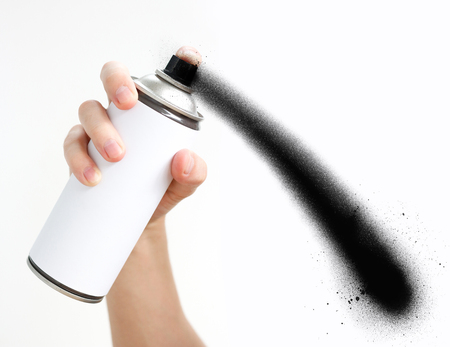 cfc: Mans hand holds a spray of black paint. Isolated on a white background. Stock Photo