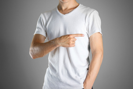 specifies: The guy in white t-shirt pointing finger on the right. Specifies the direction. Isolated. Stock Photo