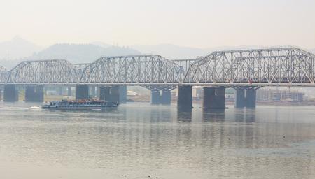 prow: A beautiful bridge. The ship sails under the bridge. Stock Photo