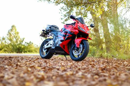 KRASNOYARSK, RUSSIA - SEPTEMBER 1, 2017: Red and black sportbike Honda CBR 600 RR 2005 PC37. Autumn yellow leaves.