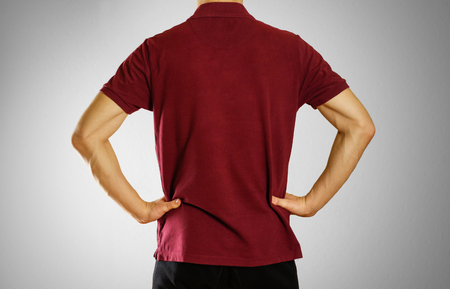 The guy in the dark red blank t-shirt Polo. Prepared for your logo.