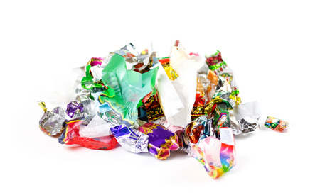 A bunch of candy wrappers on a white background. Closeup. Foto de archivo
