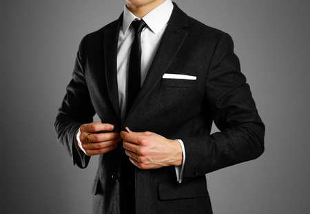 Businessman in a black suit, white shirt and tie. Studio shooting. Stock Photo