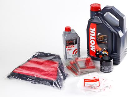 KRASNOYARSK, RUSSIA - February 26, 2018: Consumables for the motorcycle. Engine oil Motul, oil filter Honda, air filter Delo, brake fluid Brembo, brake pads Brembo. 新聞圖片