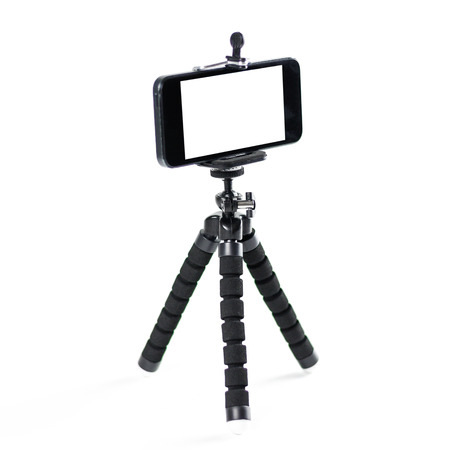 The phone on the tripod. Close up. Isolated on white background.