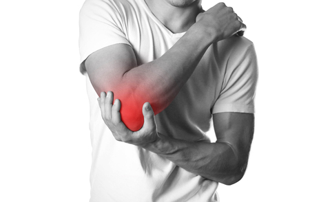 A man holding hands. Pain in the elbow. The hearth is highlighted in red. Close up. Isolated on white background.