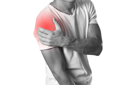 A man holding hands. Shoulder pain. The hearth is highlighted in red. Close up. Isolated on white background.