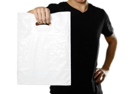 A man holding a white plastic bag. Close up. Isolated on white background.