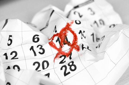 Valentines day and Holidays concept. Unhappy love. February 14th crossed out on the calendar. Close up.