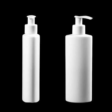 White bottle with liquid soap. Close up. Isolated on black background.