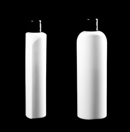 White shampoo bottle. Close up. Isolated on black background.