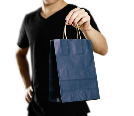 Man holding a gift bag. Close up. Isolated on white background.