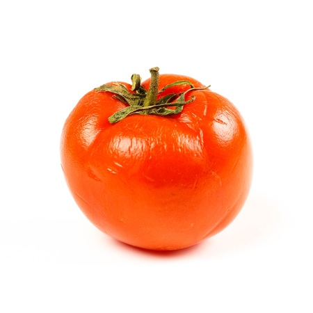 The sickly red tomato. Close up. Isolated on white background. Stock Photo