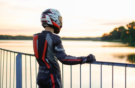 KRASNOYARSK, RUSSIA - May 29, 2018: Beautiful motorcyclist in full gear and helmet.