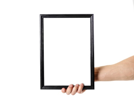 Hand holding black A4 frame. An empty frame with a white background. Close up. Isolated on white background.