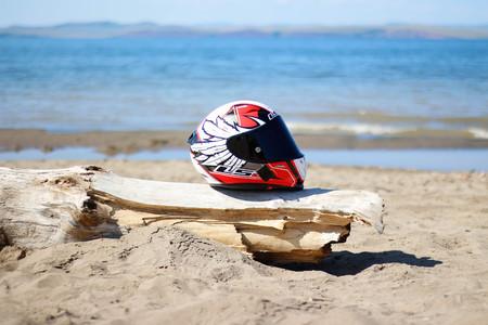 KRASNOYARSK, RUSSIA - August 9, 2018: Helmet lying on the beach. Equipment on the beach by the sea.