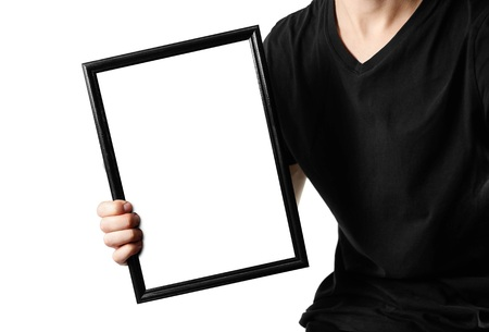 A man holds a black A4 frame. An empty frame with a white background. Close up. Isolated on white background.