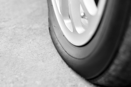 Flat tire on the car. Silver forged wheel. Close up. Stock Photo