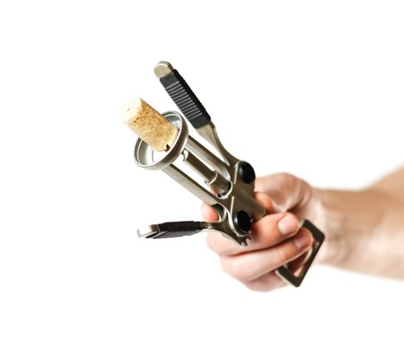 Hand holding a corkscrew. Close up. Isolated on white background.