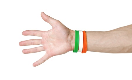 Colored rubber bracelets on the arm. Close up. Isolated on white background.