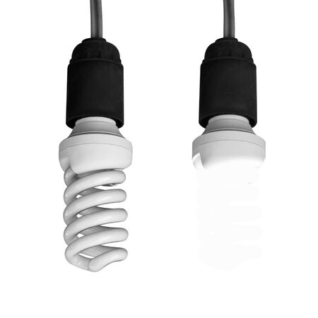 Energy saving light bulb on white background. On and off. Close up.