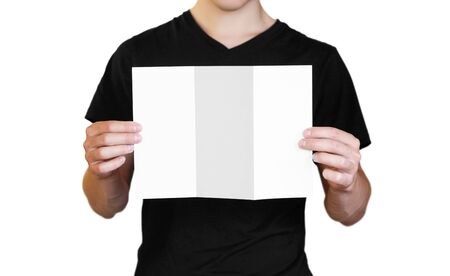 A man holding a white sheet of paper. Holding a booklet. Close up. Isolated on white background.