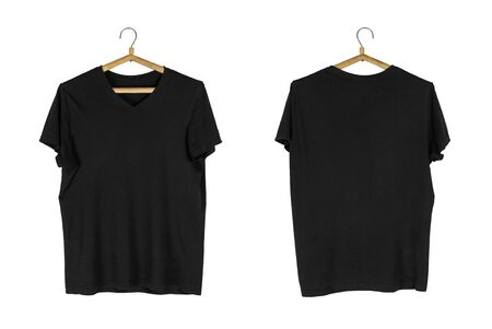 A black t-shirt hangs on a wooden hanger. Close up. Isolated on white background. Stock Photo
