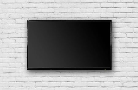 LCD TV with a thin black frame hanging on a white brick wall. Blank black screen. Isolated on white background.
