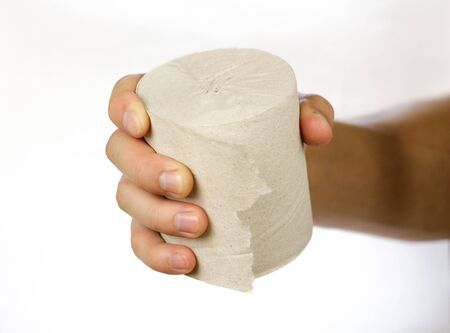 Hand holding a roll of toilet paper. Close up. Isolated on white background.