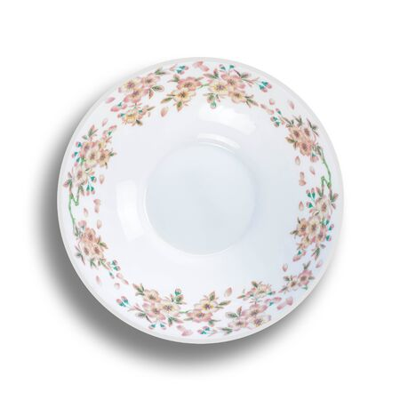 Plate with a picture of flowers. Close up. Isolated on white background.
