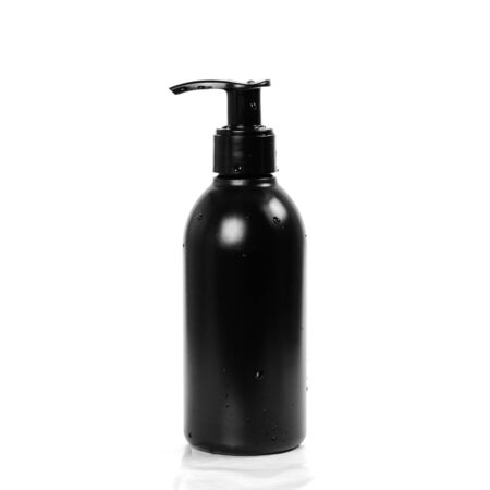 Black bottle with liquid soap dispenser. Close up. Isolated on white background.