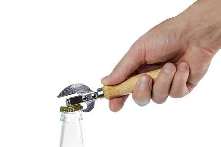 Hand opens a bottle of beer opener.